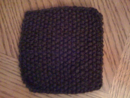 The main feature is that this piece is bumpy before blocking, but also check out those uneven edges.