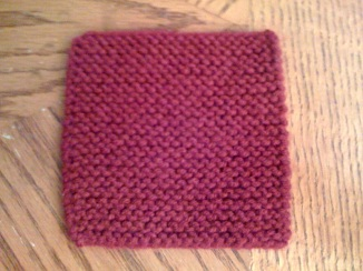 After blocking, it's completely flat and a bit softer and thinner.